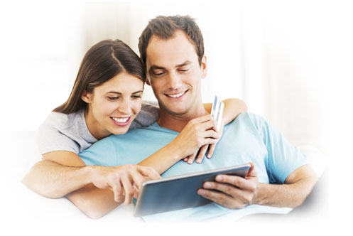 Happy couple looking at iPad screen